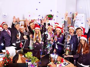 32444945 - happy group people in santa hat at xmas business party.